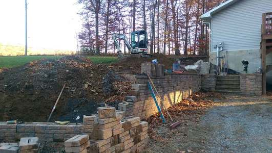 A Failed Retaining Wall - Being Repaired - Buyer Beware