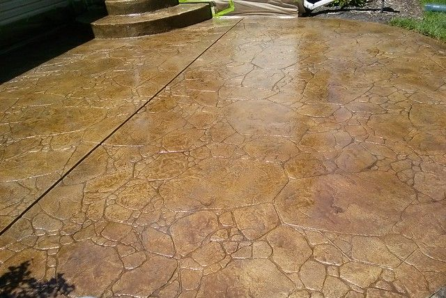 Light brown stamped concrete patio.
